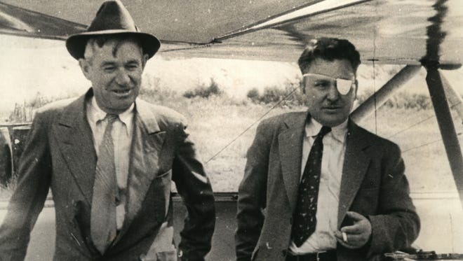 Humorist Will Rogers (left) and flying wiz Wiley Post pose for a Hearst Metrotone News cameraman just before they take off from Seattle, for Juneau, Alaska, in the summer of 1935. Rogers and Post were both killed when their plane crashed near Point Barrow, Alaska, on Aug. 15, 1935.