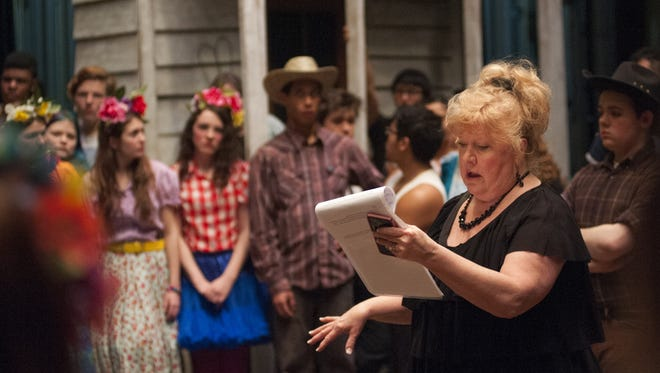 """Cynthia Hartshorn gives direction and encouragement to student actors moments before their performance of """"The Wizard of Oz"""" on Friday, Feb. 26, 2016, at Tech High School. Hartshorn, who has been the director of the music department at Tech for 30 years, will retire in June."""