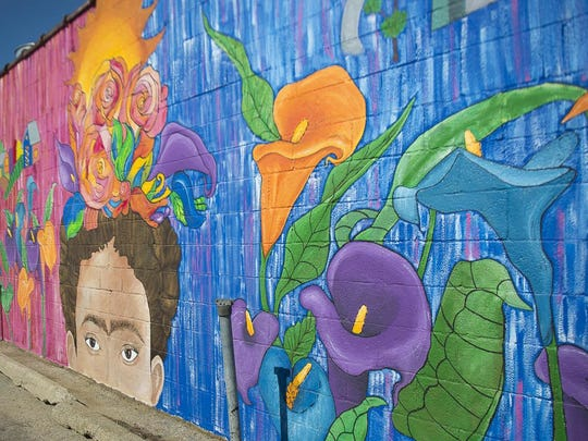 Green Bay Area School District students unveiled a mural Thursday on the side of Los Banditos East on Main Street that is dedicated to Mexican artist Frida Kahlo.