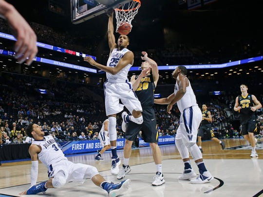 Villanova's Mikal Bridges (25) follows up on a shot by Josh Hart (3) as Iowa's Jarrod Uthoff (20) watches during the first half of a second-round men's college basketball game in the NCAA Tournament, Sunday, March 20, 2016, in New York.