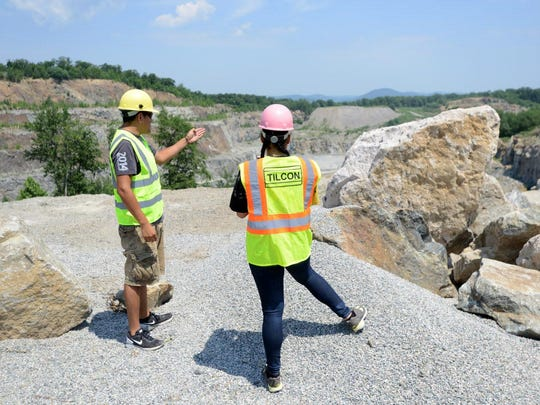 Students Bryan Gonzalez of Hackensack and Sally Fernandez of Paterson looking over the Tilcon quarry in Pompton Lakes during a class trip.