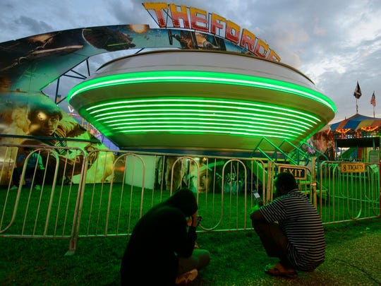 People wait for The Force ride during the Champlain Valley Fair on Wednesday evening August 29.