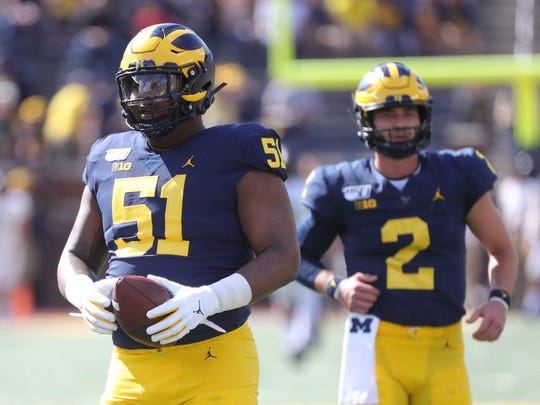 Michigan center Cesar Ruiz warms up before action against the Army Golden Knights Saturday September 7, 2019 at Michigan Stadium in Ann Arbor, Mich. Michigan Football