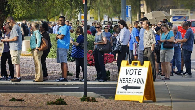 People wait in line to vote at Mountain View Lutheran Church in Phoenix, March 22, 2016.