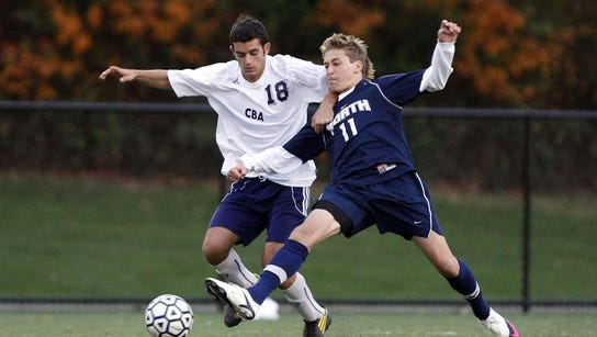 CBA's Nick Villani (18) battles with Toms River North's