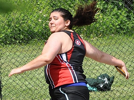 Rye's Katrina Roth prepares to release the discus during the Class B Track and Field Championships.