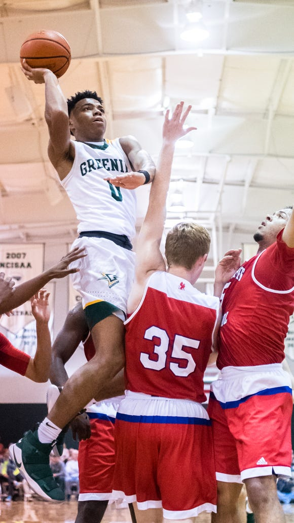 Christ School's Jalen Lecque jumps up for a shot during