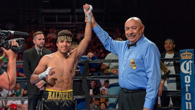 Karlos Balderas gets his arm raised in victory after his fight with Eder Amaro Fajardo in July.