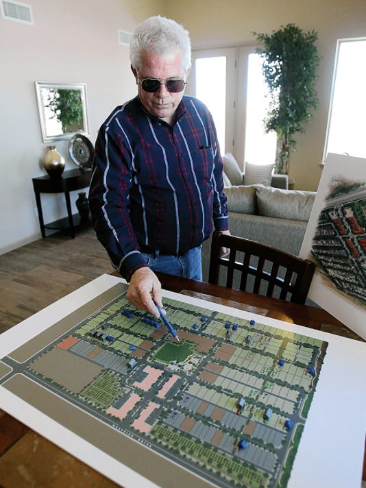 Rudy Gutierrez—El Paso Times Scott Winton, of The Winton Group, looks at a Rio Valley subdivision plan last week inside a recently completed Winton model home in the Upper Valley development.