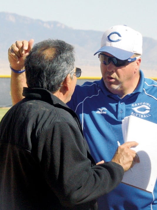 Matt Hollinshead — Current-Argus Coach Bobby Howard argues with the umpire crew chief about a scoreboard ruling in the state tournament Thursday, May 15, 2014 at Cleveland High. Howard will not return for the 2016 season.