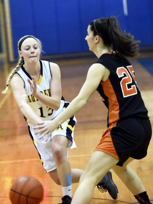 Greencastle's Hannah Crist (13) throws a bounce pass around Olivia Embleton (25) of East Pennsboro during the District 3-AAA first round game on Wednesday. Crist hovered near a triple-double, finishing with 16 points, eight rebounds and nine assists in the Blue Devils' 68-55 win.