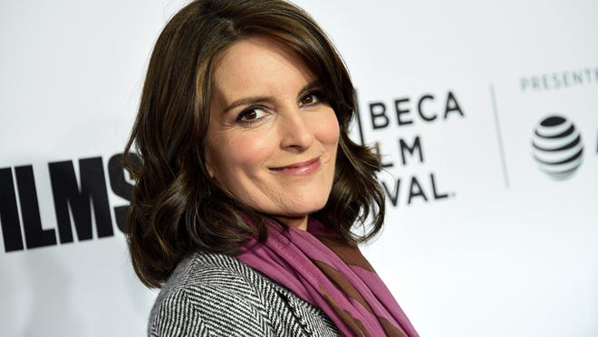 """Tina Fey attends the 2018 Tribeca Film Festival world premiere of """"Love, Gilda"""" in New York. The cast of """"30 Rock,"""" including Fey, Alec Baldwin and Tracy Morgan, will reunite to promote NBCUniversal shows for the 2020-21 season."""