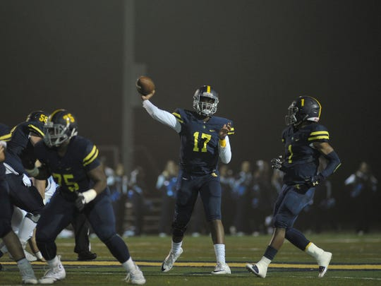 Northpoint Lausanne during Lausanna Collegiate quarterback  Schyler Forest (17) attempts a pass during the first quarter action of their Division II-AA playoff game, Friday, November 3, 2017.