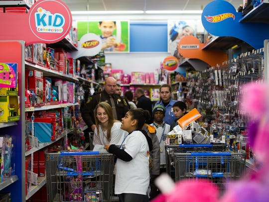 The aisles at Wal-Mart fill with children and officers