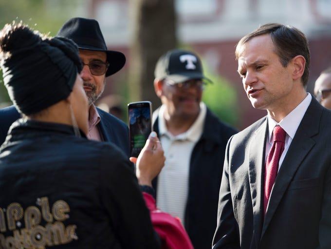 Marshall Stair speaks on camera as community members