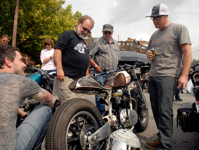 Allen Dunagan, left, John Lippy, Roy McMeans, and Kacey Elkins check out Elkins '79 Yamaha XS 650 Cafe Racer at the Kentucky Kickdown vintage motorcycle show on Barret Ave.  Sept. 20, 2014
