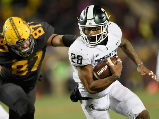 Michigan State running back Madre London carries the