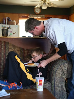 Michael Jones implores Landon to eat some fast food after he barely nibbled at his lunch at school. Eventually, Landon retreated to another room to be force-fed away from the prying eyes of strangers.