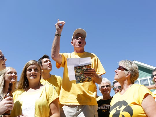 Carl Schwendinger, a poet from Iowa City, reads a poem relevant to the Hawkeyes' football game against Ball State on Sept. 6 at Kinnick Stadium.