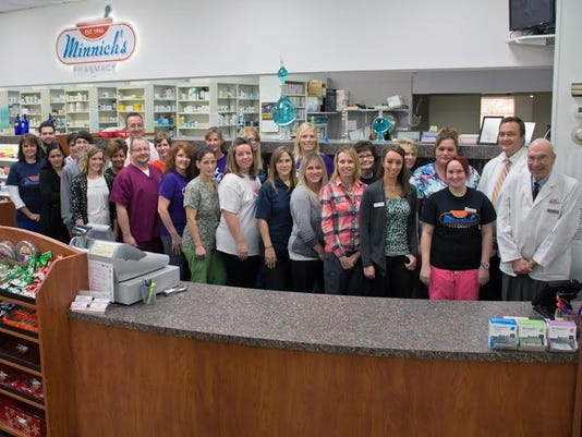 Minnich's Pharmacy President Scott Miller (back row, far right) appears with the pharmacy's staff. Minnich's is a partner of the Million Hearts initiative in York City because treatment is key to improving heart health. In a few weeks, community members will be able to track their blood pressure using a high-tech monitor, free of charge, at the shop on South George Street.