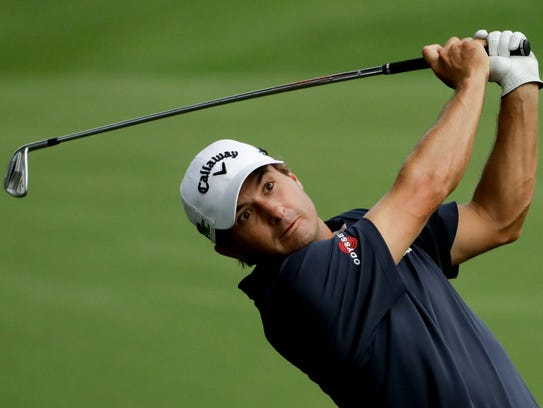 Kevin Kisner hits from the fairway on the 18th hole