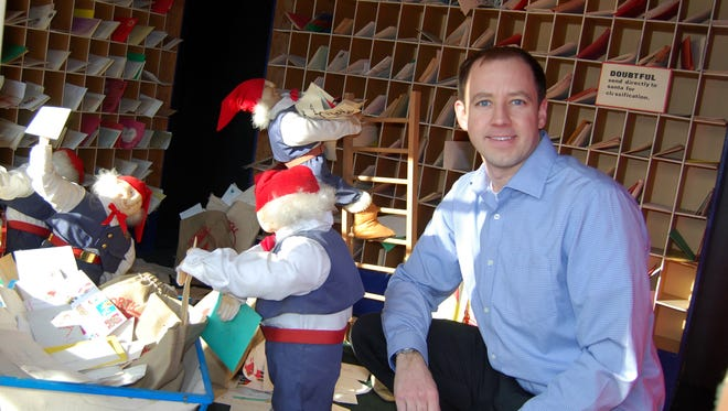 Bill Spinnenweber, general manager of the Mariemont Inn, bought the Shillito's Christmas elves display that once were in Shillito's department store and set up three scenes in the Mariemont Square.