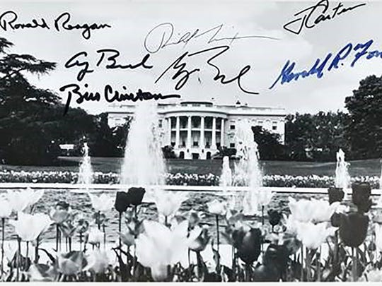 Last year, this White House photograph with seven presidential signatures sold at auction for $3,750.