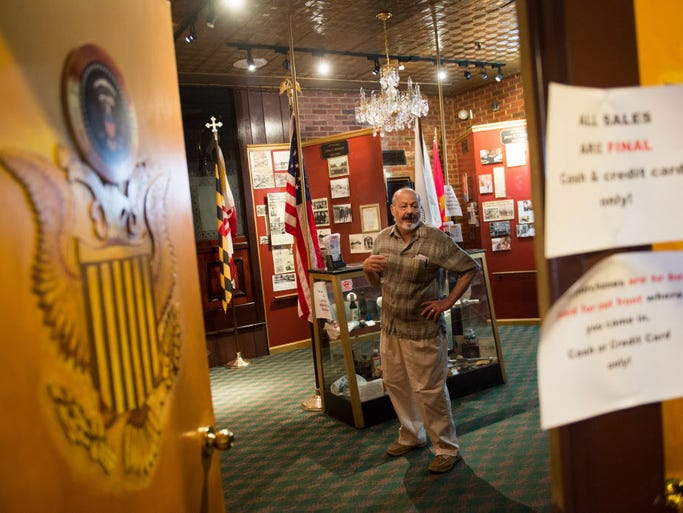 Jerry Freeze, the current owner of The Cozy Restaurant,  looks through items in the The Camp David Museum inside the closed business, which served customers since 1929.