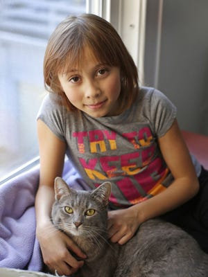 Makayla Zavrl, 9, poses with her cat at her home Tuesday March 8, 2016 in Sheboygan.  Zavrl was bullied and her family took steps to help stop the problems.