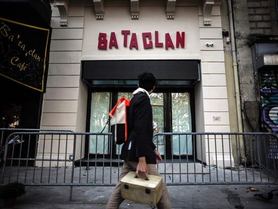 A man walks past the Bataclan concert hall in Paris,