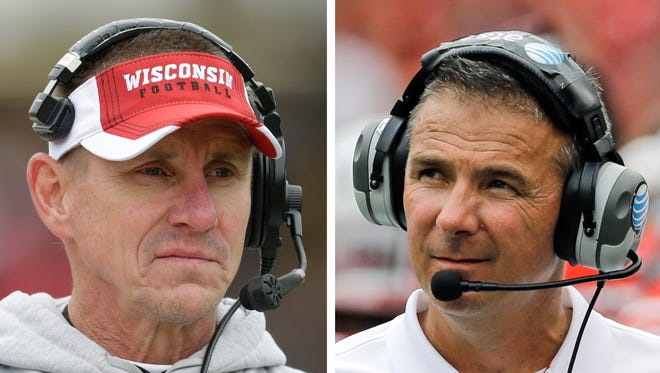 Wisconsin coach Gary Andersen, left, worked for Ohio State coach Urban Meyer at Utah, where they led the Utes to an unbeaten season in 2004.  Saturday, they face off in the Big Ten championship game.