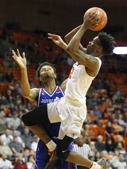 UTEP guard Omega Harris soars to the basket in a shot