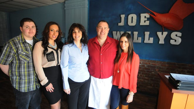 From left, Joseph Willy White, 16, Stephanie White, 21, Dena White, Joseph White and Victoria White, 19, stand for a portrait in their restaurant, Joe Willy's Seafood House Sunday, April 14, 2013, in Fishkill. 4/14/13