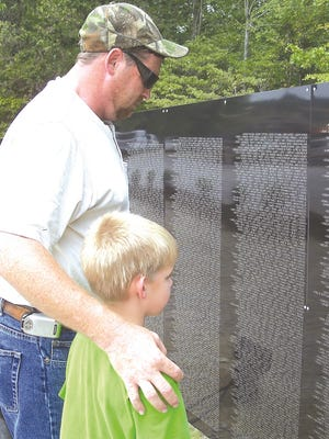 In 2007, the last time the Wall That Heals stopped in Dickson, Sam and Dylan Jones looked at the touring memorial.