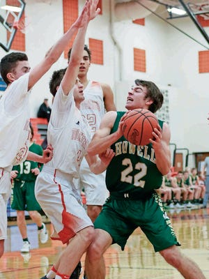 Howell forward Dan Zolinski (22) scored a team-high 15 points as the Highlanders stormed back from a double-digit deficit in the fourth quarter to beat Novi.