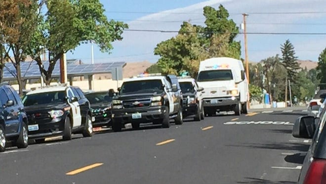A submitted photo of Reno police investigating a call of a hand grenade found under a dumpster Thursday morning on Washington Street in Reno.