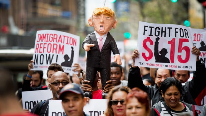 Protesters hold a pinata of Donald Trump in Chicago in 2015.