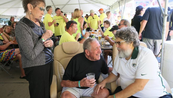 Chris Kegel (right) talks with his aunt and uncle, Nancy and Jack Winter of West Allis, at the Chris Kegel Slow Roll party outside Kegel's Inn, 5901 W. National Ave. on Sunday.