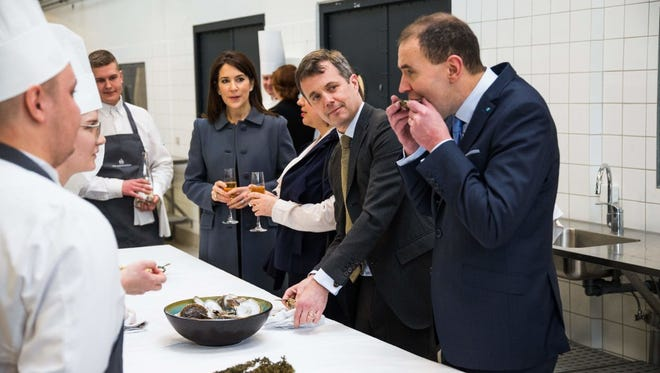 President of Iceland Gudni Johannesson visits a cooking school in Denmark with members of the Danish royal family in January.