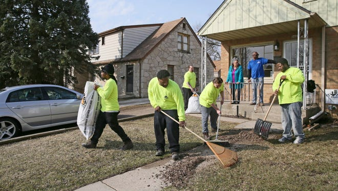 A group of men from the House of Correction is working on a home in the 5600 block of N.27th St.  They are working with Ezekiel Community Development Corp., one of the organizations the city is recommending to purchase $1 homes in the Sherman Park neighborhood.  The workers are  Jourdain Williams (from left), JL Shackelford, Jeffrey Gleason, Derrin Barker  and Kelvin Hayes. On the porch supervising are Patricia Tate (left) and Jim Gaillard, vice president of Ezekiel Community Development Corp.