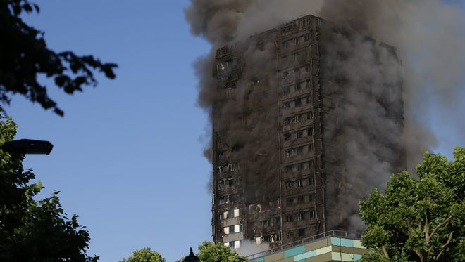 Smoke billows from Grenfell Tower as firefighters attempt to control a huge blaze on June 14, in west London.