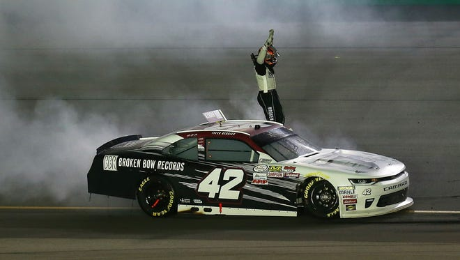 Tyler Reddick celebrates with a burnout after winning the NASCAR Xfinity Series' VisitMyrtleBeach.com 300 at Kentucky Speedway on Saturday.