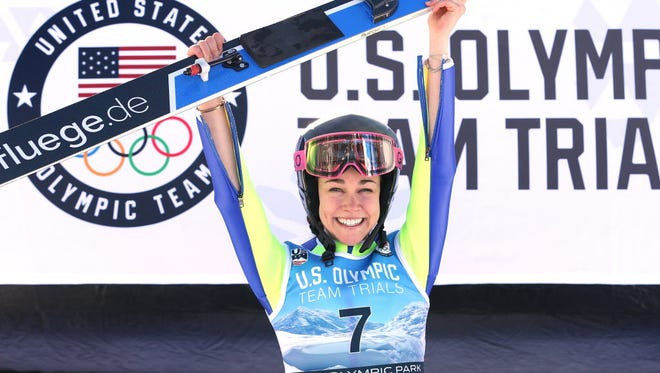 Sarah Hendrickson celebrates on the medals podium after winning the U.S. Womens Ski Jumping Olympic Trials in Park City, Utah.