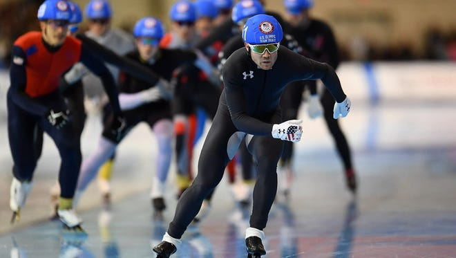 Joey Mantia leads a group of skaters in the men's mass start event during the Long Track Speed Skating Olympic Trials at the Pettit National Ice Center in Milwaukee.