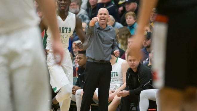 Oshkosh North coach Brad Weber instructs the players during a Feb. 16 game against Kaukauna at Oshkosh North High School.
