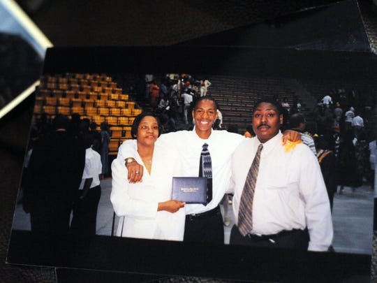 Anthony Magee of Hattiesburg, center, stands with mother Patricia Davis, left, and father Tony Davis at his high school graduation. Magee was an Army sergeant in 2010 when he was fatally wounded during an ambush by enemy forces in Iraq.