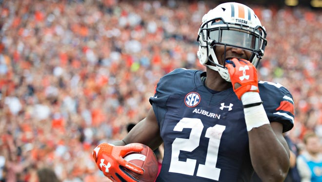 Auburn running back Kerryon Johnson (21) scores a touchdown during the NCAA football game between Auburn and Ole Miss on Saturday, Oct. 7, 2017, in Auburn, Ala.