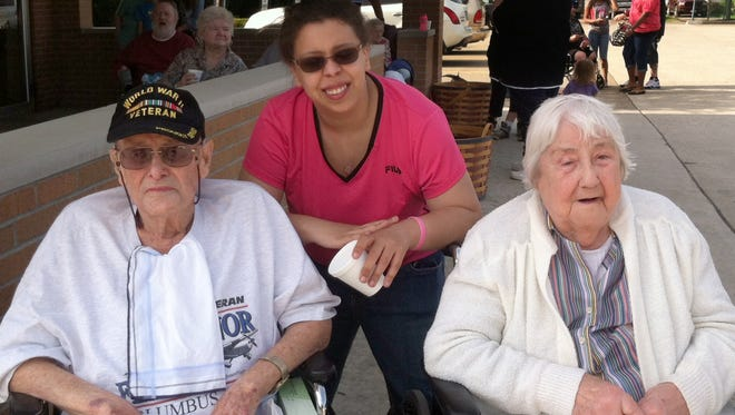 Harry Norman of Newark, Ohio, left; Melena Nixon, his great-granddaughter; and Anna Leogrande Norman, who was married to her husband for 72 years, in a May 2014 photo.
