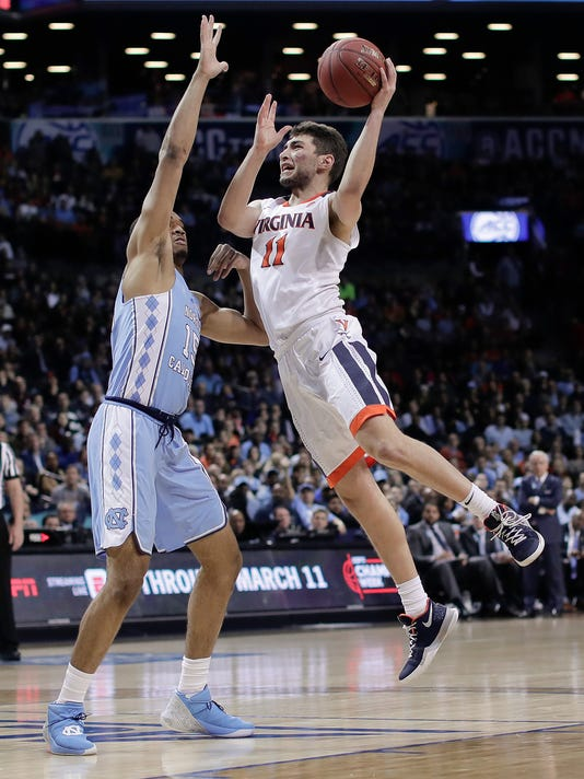 Virginia guard Ty Jerome (11) shoots against North Carolina forward Garrison Brooks (15) during the second half of an NCAA college basketball game for the Atlantic Coast Conference men's tournament title Saturday, March 10, 2018, in New York. Virginia won 71-63. (AP Photo/Julie Jacobson)