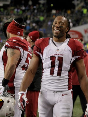 Arizona Cardinals wide receiver Larry Fitzgerald (11) reacts on the sideline in the second half of an NFL football game against the Seattle Seahawks, Sunday, Nov. 15, 2015, in Seattle. The Cardinals beat the Seahawks 39-32.